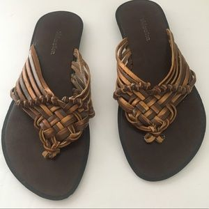 Braided bronze/brown faux leather flip flops